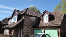 installation of new rosewood UPVC shiplap cladding fascias soffits UPVC brown guttering