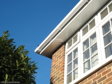 white square guttering white fascia and soffit after installation