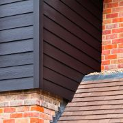 Midnight black hardieplank weatherboard cladding