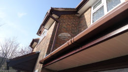 Brown square guttering rosewood fascia white soffit Winchester