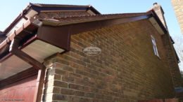 Box end detail of rosewood fascias, white soffit and brown square guttering