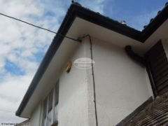 UPVC plain soffit with black fascia and guttering