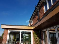 Replace flat roof, fascias and soffits