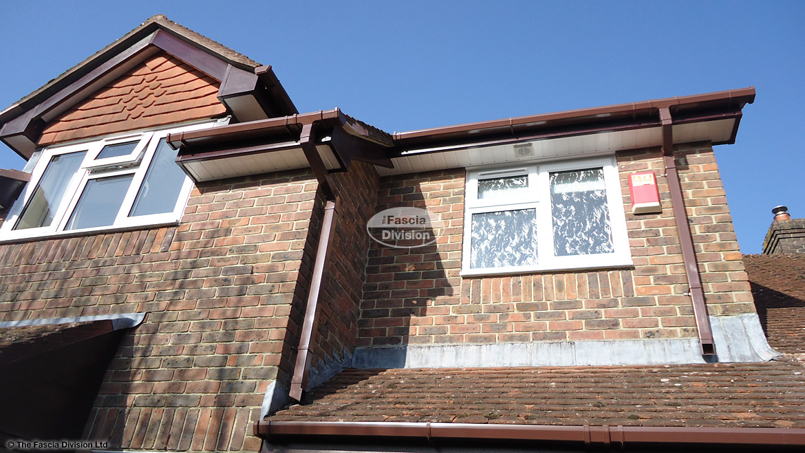 Rosewood bargeboards and fascia with brown square guttering and white soffits Winchester